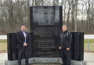 Ontario Regional Chief Isadore Day with Bkejwanong/Walpole Island Chief Dan Miskokomon at the Indian Residential School Memorial in the First Nation.